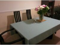 Solid wood dinning table (6-8 seater) and 6 chairs