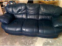 Three seater dark blue sofa.