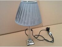 Smart glass and chrome table lamp including grey pleated shade