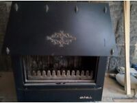 Woodburning stove. Pretty woodburning stove. Buyer collects. Free as door is missing
