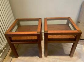 Pair of glass topped wooden side tables