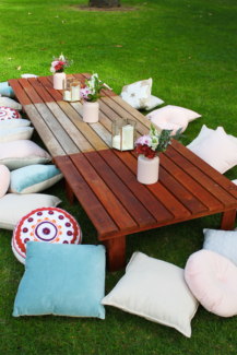 Party hire - Boho picnic tables, cushions and plenty more