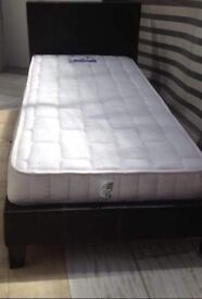 Very good condition single dark brown leather bed frame with mattress.