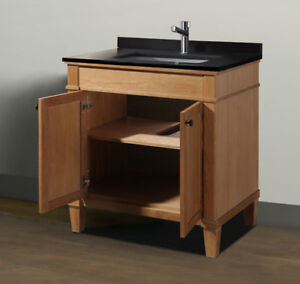 "Brand new, never installed 31"" solid Oak vanity set with top and"