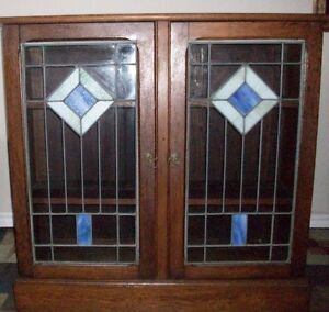ANTIQUE OAK BOOKCASE WITH LEADED STAIN GLASS DOORS