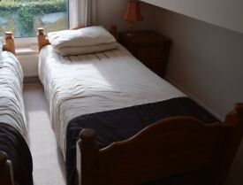 Two solid Pine single beds