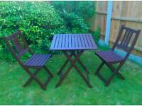 Wooden fold up table and chairs. New condition