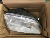 Set of renault headlights, new and packaged!