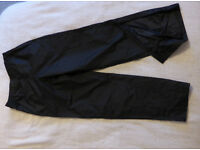 Almost new Dunlop Waterproof over-trousers in size S