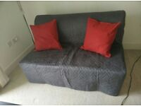 Sofa ved with grey and white cover