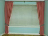 One pair of fully lined, pinch pleat lounge curtains with tiebacks - (salmon) pink with aqua trim.