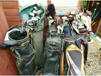Job lot of golf clubs and bags