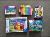 Selection of preschool puzzles and books