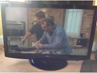 LG 42 inch LCD Freeview TV with Stand Model-42LH2000 in very good condition
