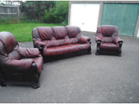 Reddish brown leather and wood framed suite