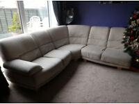 Corner sofa with coffee table attachment