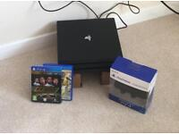 PS4 Pro boxed with 2 games
