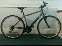 Bike hibrid. 7 month old Perfect condition. 18 shimano gears Shiny, man or ladies.