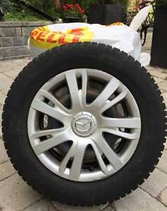Mazda 195/65R15 91T Pirelli Carving Edge Snow Tires and Wheels