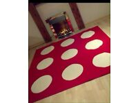 LARGE RED AND CREAM RUG £20