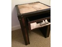 Leather side table.