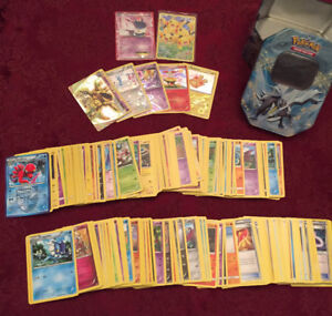 370 pokemon cards + tin and toy