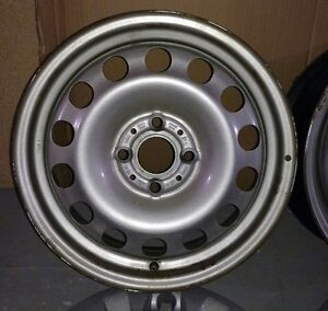 16inch Metal Rims and Wheel Covers... 4X100 Bolt Pattern