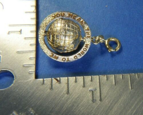 """SPINNING """"YOU MEAN THE WORLD TO ME"""" Vintage washed gold tone charm MONET A25"""
