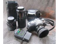 Minolta X300 Camera. Complete package including 3x Lenses - 50mm 35-70mm 80-200mm, Flash and Bag.