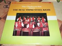 THE REAL THING STEEL BAND  ( COCA COLA)