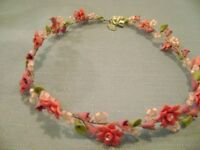 pink floral necklace or headpiece