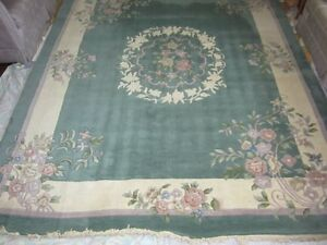 100% Wool, 8' x 10' hand knotted carpet.