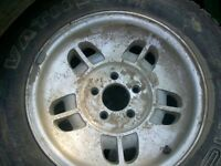 set of 4 rims and tires from 95 ford explorer