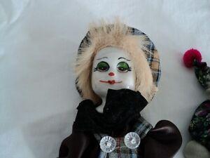 Porcelain Clown Collection 7 different clown figures are left