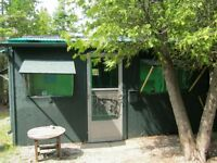 CAMPING CABINS/TENTING at  WHISPERING CEDARS
