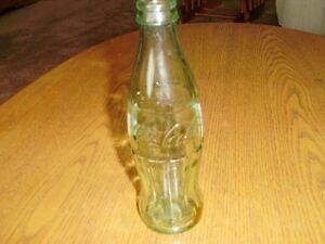 Vintage 8 fl oz.green Coca-Cola bottle