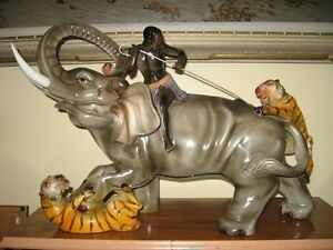 X LARGE CERAMIC ELEPHANT with TIGERS  SCULPTURE .