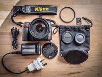 Nikin D90 with a 18-200 VR lens, spare battery, UV filter etc.