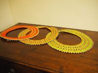 Three beaded Maasai necklaces from Arusha, Tanzania. Red, yellow and green