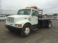 1998 International Roll Off Truck at Auction