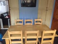 solid wood dining table, and 8 chairs