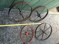 2 small antique steel wheels