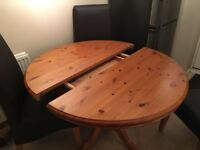 Ducal pine pedastal round extendable table with 4 leather high back chairs