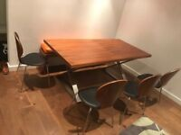 Dining table and 4 leather walnut Chairs from Dwell. Delivery Possible
