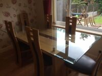 Solid wood and glass dining table with 6 chairs