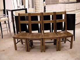 A set of four Walnut dining chairs
