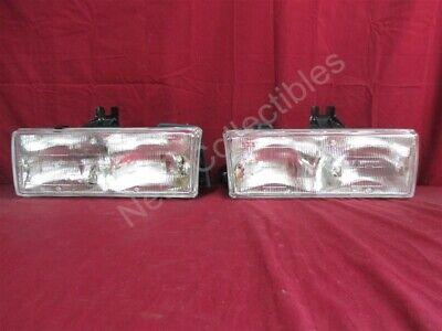 NOS OEM Cadillac Deville FWD Head Lamp Light 1987 - 1990 PAIR