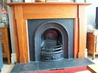 Cast iron fireplace and wooden mantel