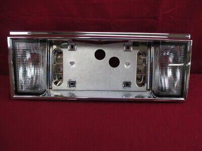 NOS OEM Cadillac Deville, Fleetwood Back Up Lamp License Plate Holder 1989 - 90
