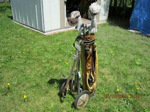 used set of golf clubs with cart